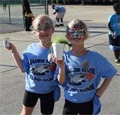 Children attend the Grove Neighborhood Block Party at Abram Frink Jr. Community Center